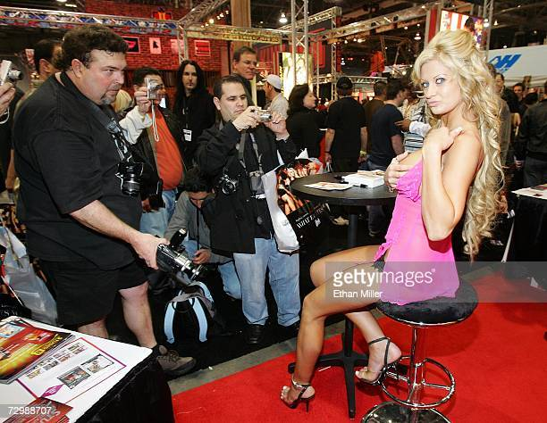 Adult film actress Jenna Cumz poses while signing autographs for fans at the Adult Video News Adult Entertainment Expo at the Sands Expo Center...