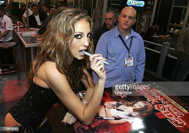 Adult film actress Jenna Haze poses as she signs autographs for fans at the Jules Jordan Video booth at the Adult Video News Adult Entertainment Expo...