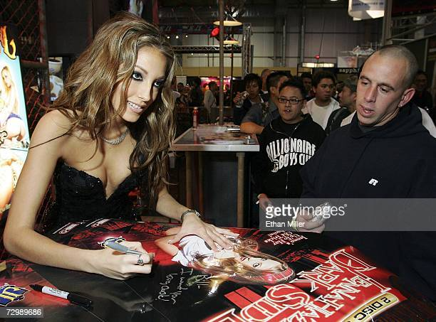 Adult film actress Jenna Haze signs autographs for fans at the Jules Jordan Video booth at the Adult Video News Adult Entertainment Expo at the Sands...