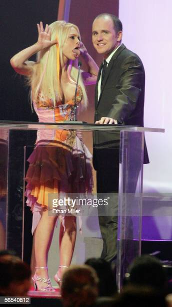 Adult film actress Jesse Jane makes a face at her cohost comedian Greg Fitzsimmons during the Adult Video News Awards Show at the Venetian Resort...