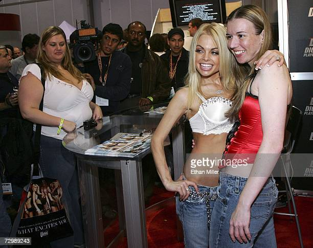 Adult film actress Jesse Jane poses with fan Nicole Kinstle of California as Jane signs autographs at the Adult Video News Adult Entertainment Expo...