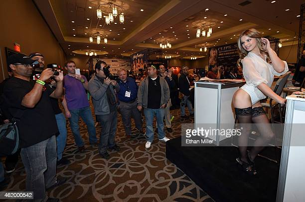 Adult film actress Jillian Janson poses for attendees at the Jules Jordan Video booth at the 2015 AVN Adult Entertainment Expo at the Hard Rock Hotel...
