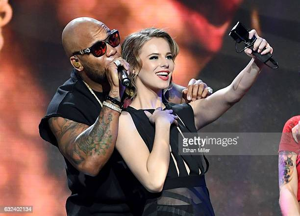 Adult film actress Jillian Janson records herself with rapper Flo Rida as he performs during the 2017 Adult Video News Awards at The Joint inside the...