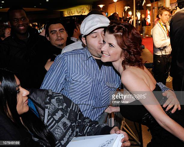 Adult film actress Joslyn James gets a kiss from a fan as she arrives at the 28th annual Adult Video News Awards Show at the Palms Casino Resort...