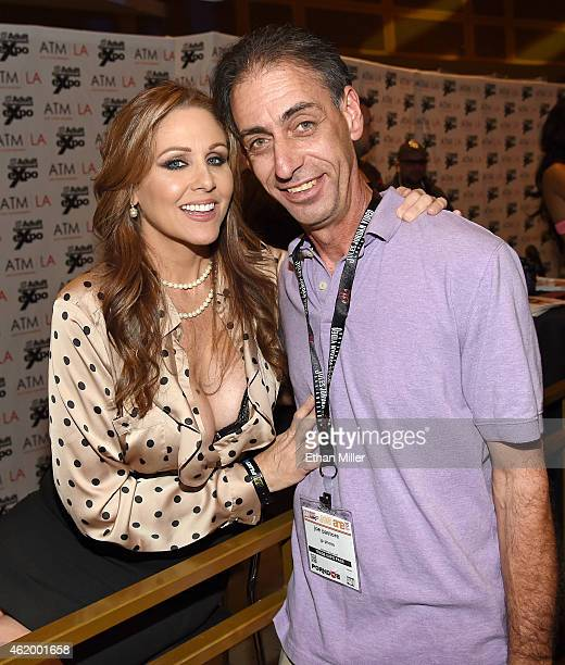 Adult film actress Julia Ann poses for a photo with Joe Pastore at the 2015 AVN Adult Entertainment Expo at The Joint inside the Hard Rock Hotel...