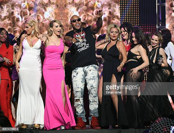 Adult film actress Katie Banks and other audience members dance with rapper Flo Rida as he performs during the 2017 Adult Video News Awards at The...