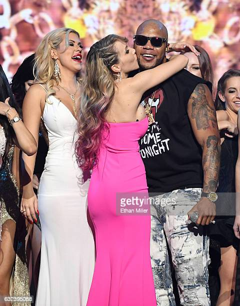 Adult film actress Katie Banks kisses rapper Flo Rida on stage as he performs during the 2017 Adult Video News Awards at The Joint inside the Hard...