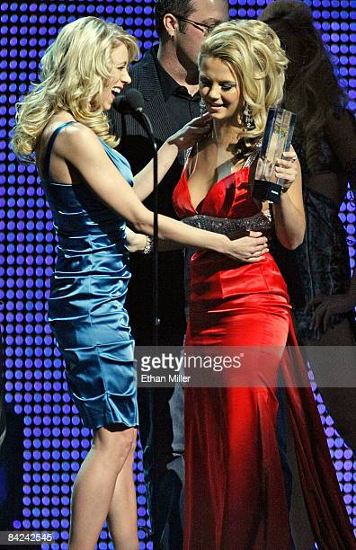 Adult film actress Katie Morgan presents the award for Best Interactive DVD to adult film actress Ashlynn Brooke during the 26th annual Adult Video...