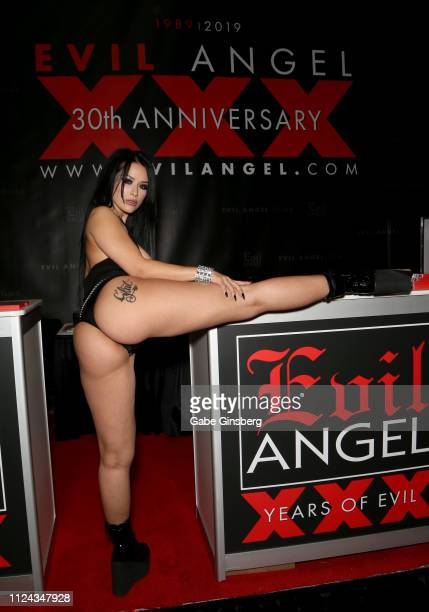 Adult film actress Katrina Jade poses in the Evil Angel booth at the 2019 AVN Adult Entertainment Expo at the Hard Rock Hotel Casino on January 23...