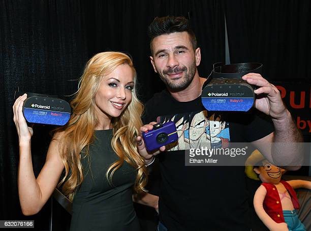Adult film actress Kayden Kross and adult film actor/director Manuel Ferrara hold RubyVR customizable viewer headsets at the RubyVR booth at the 2017...