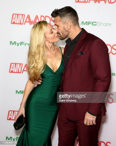 Adult film actress Kayden Kross kisses adult film actor/director Manuel Ferrara during the 2019 Adult Video News Awards at The Joint inside the Hard...