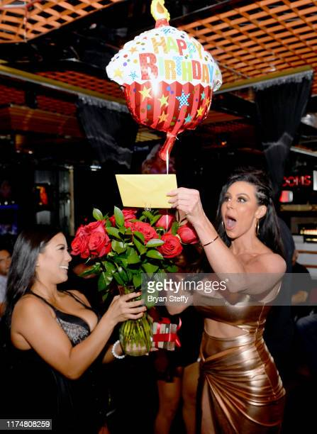 Adult film actress Kendra Lust is presented a bouquet of roses and a balloon during her birthday celebration at the Crazy Horse 3 Gentlemen's Club on...
