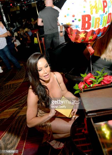 Adult film actress Kendra Lust opens a birthday card during her birthday celebration at the Crazy Horse 3 Gentlemen's Club on September 14 2019 in...