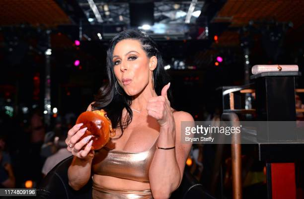 Adult film actress Kendra Lust samples Crazy Horse 3's signature burger during her birthday celebration at the Crazy Horse 3 Gentlemen's Club on...