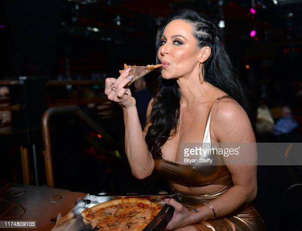 Adult film actress Kendra Lust samples Crazy Horse 3's signature pizza during her birthday celebration at the Crazy Horse 3 Gentlemen's Club on...