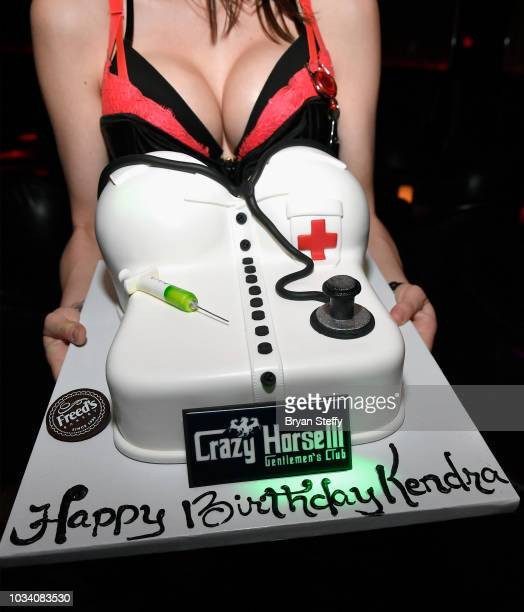 Adult film actress Kendra Lust's birthday cake is presented to her as she hosts her birthday party celebration at Crazy Horse 3 Gentlemen's Club on...