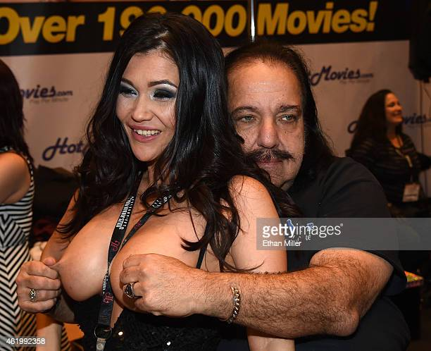 Adult film actress Kiana Bradley jokes around with adult film actor Ron Jeremy at the HotMoviescom booth at the 2015 AVN Adult Entertainment Expo at...