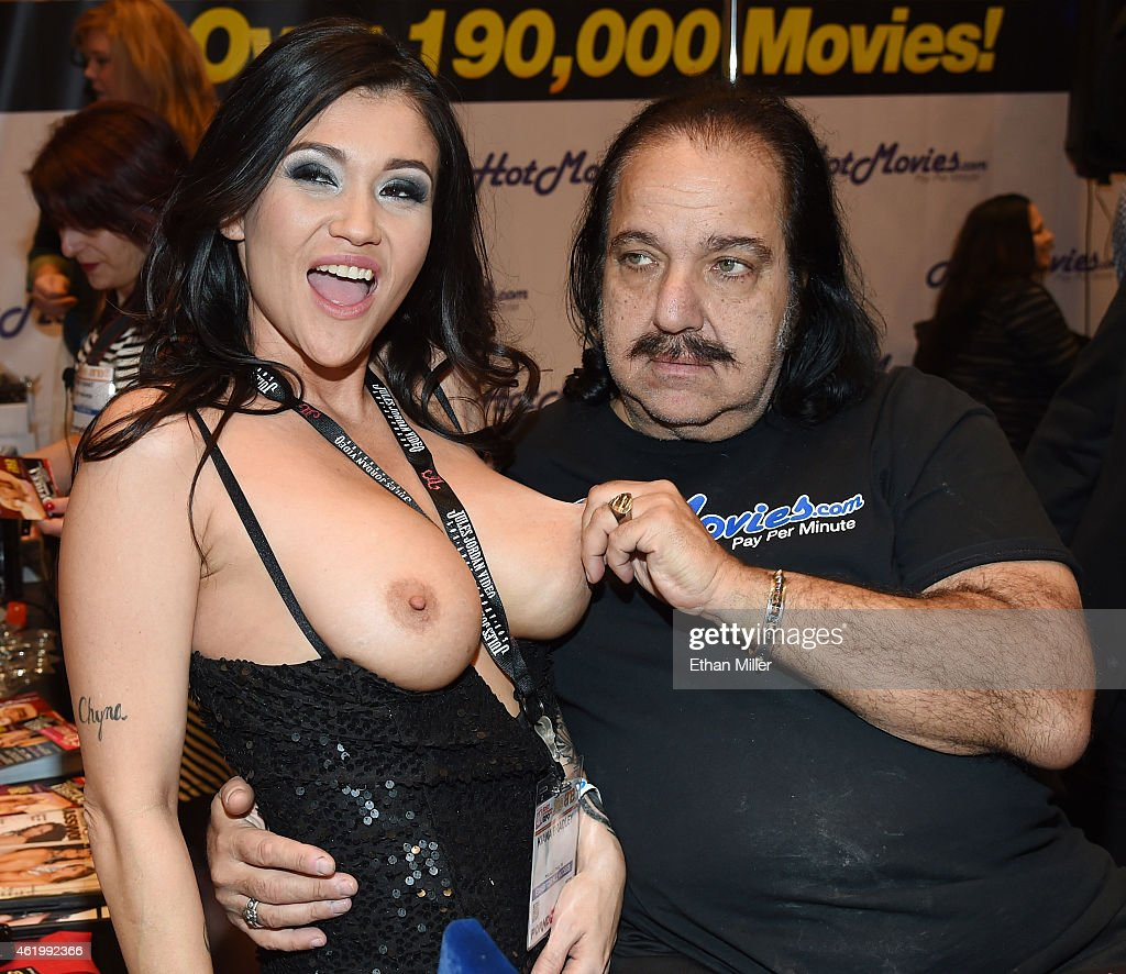 Adult film actress Kiana Bradley (L) jokes around with adult film actor Ron Jeremy at the HotMovies.com booth at the 2015 AVN Adult Entertainment Expo at the Hard Rock Hotel & Casino on January 22, 2015 in Las Vegas, Nevada.