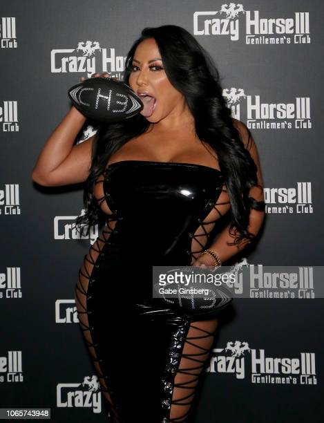 Adult film actress Kiara Mia licks a football as she arrives at the Crazy Horse 3 Gentlemen's Club to host a party on November 10, 2018 in Las Vegas,...