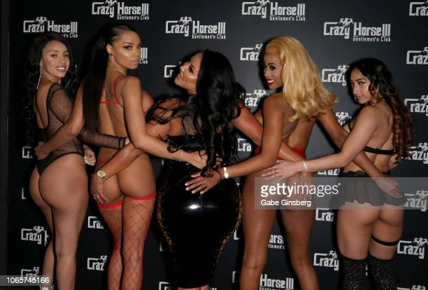Adult film actress Kiara Mia poses with Crazy Horse 3 entertainers at the Crazy Horse 3 Gentlemen's Club to host a party on November 10 2018 in Las...