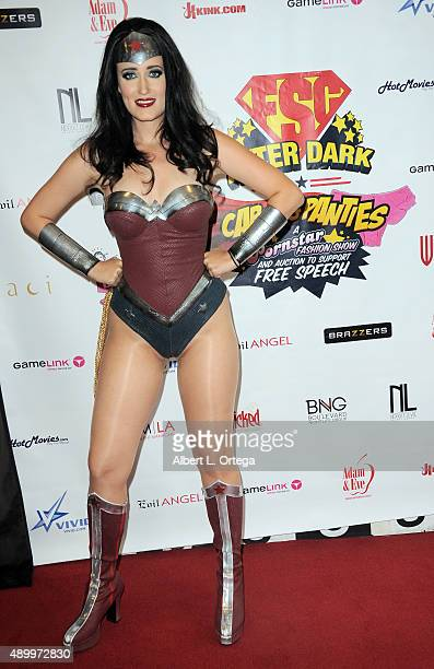 Adult film actress Kimberly Kane as Wonder Woman at FSC After Dark Capes Panties A Superhero Costume Lingerie Auction and Silent Auction to Benefit...