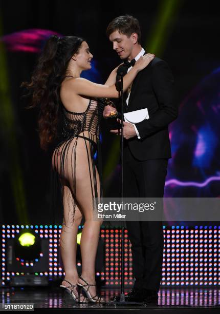 Adult film actress Lana Rhoades and adult film actor Markus Dupree accept an award during the 2018 Adult Video News Awards at The Joint inside the...