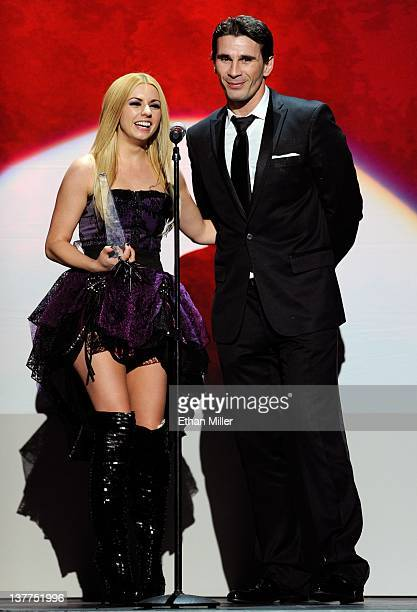 Adult film actress Lexi Belle and adult film actor/director Manuel Ferrara accept an award during the 29th annual Adult Video News Awards Show at The...