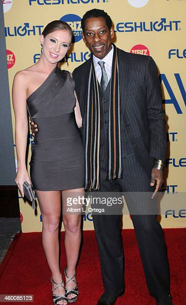 Adult Film Actress Maddy O'Reilly and actor Orlando Jones arrive for the 2013 XBIZ Awards held at the Hyatt Regency Century Plaza on January 11 2013...