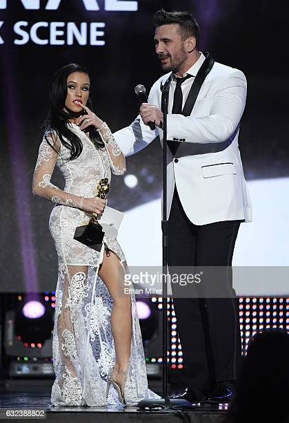Adult film actress Megan Rain and adult film actor/director Manuel Ferrara accept an award during the 2017 Adult Video News Awards at The Joint...