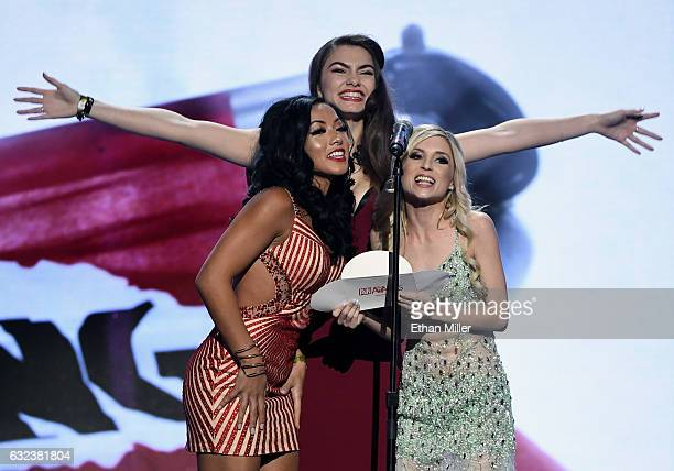Adult film actress Morgan Lee webcam model Chroniclove and adult film actress Piper Perri present an award during the 2017 Adult Video News Awards at...