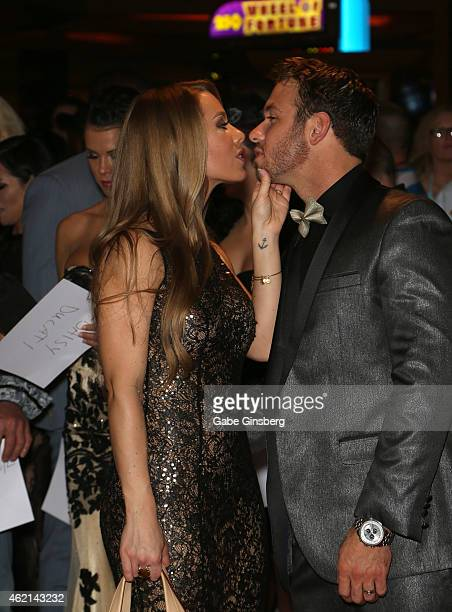 Adult film actress Nicole Aniston kisses adult film actor Chad White as they arrive at the 2015 Adult Video News Awards at the Hard Rock Hotel Casino...