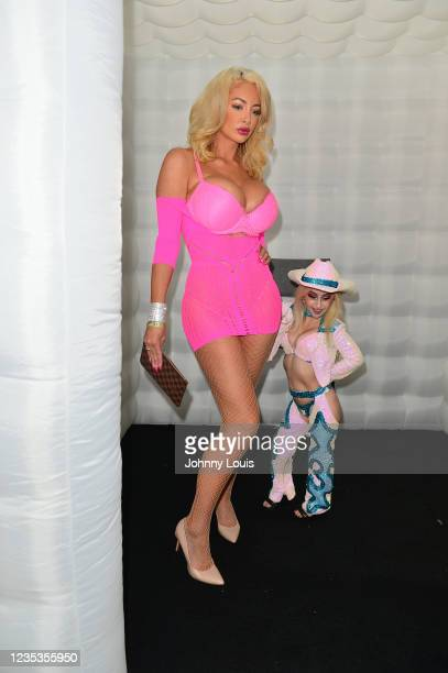 Adult film actress Nicolette Shea and Tiny Texie attend the EXXXOTICA Expo 2021 at Miami Airport Convention Center on September 17, 2021 in Miami,...