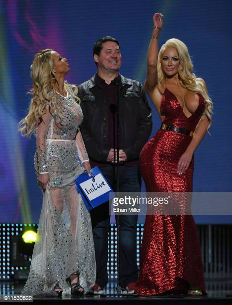 Adult film actress Nikki Benz, comedian/actor Doug Benson and adult film actress Nicolette Shea present an award during the 2018 Adult Video News...