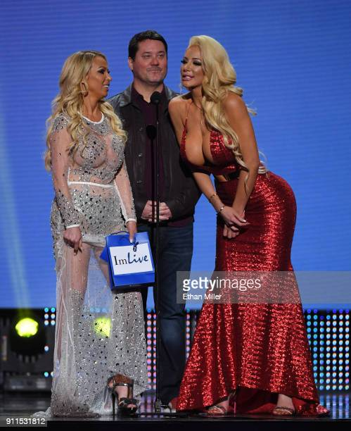 Adult film actress Nikki Benz comedian/actor Doug Benson and adult film actress Nicolette Shea present an award during the 2018 Adult Video News...