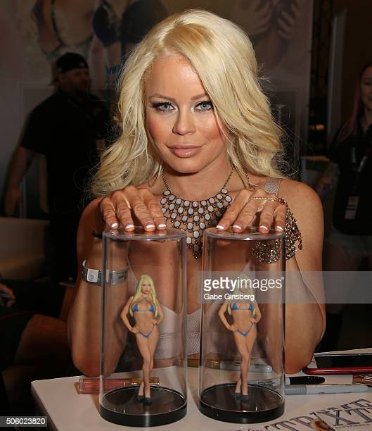 Adult film actress Nikki Delano poses with Nikki Delano dolls during attends the 2016 AVN Adult Entertainment Expo at the Hard Rock Hotel Casino on...
