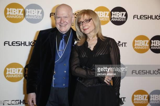Adult film actress Nina Hartley and husband Ernest Greene arrive at the 2015 Xbiz Awards in Los Angeles USA on 15 January 2015 Photo Hubert Boesl...
