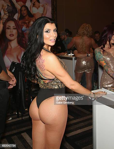 Adult film actress Romi Rain appears at the Brazzers booth during the 2017 AVN Adult Entertainment Expo at the Hard Rock Hotel Casino on January 18...