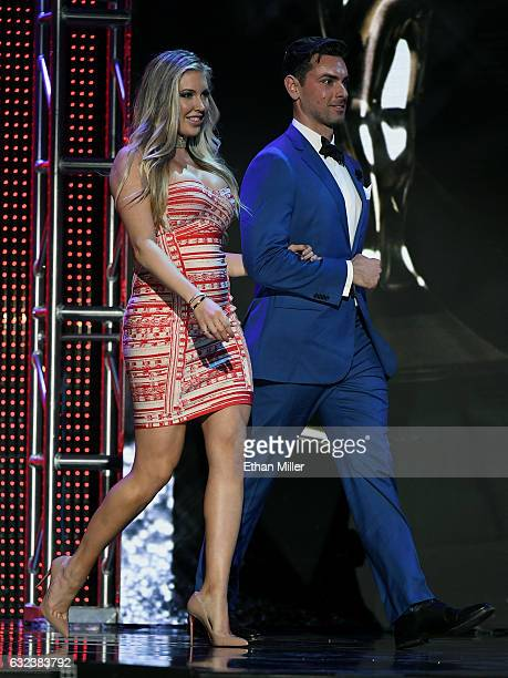 Adult film actress Samantha Saint and adult film actor Ryan Driller walk on stage to present an award during the 2017 Adult Video News Awards at The...