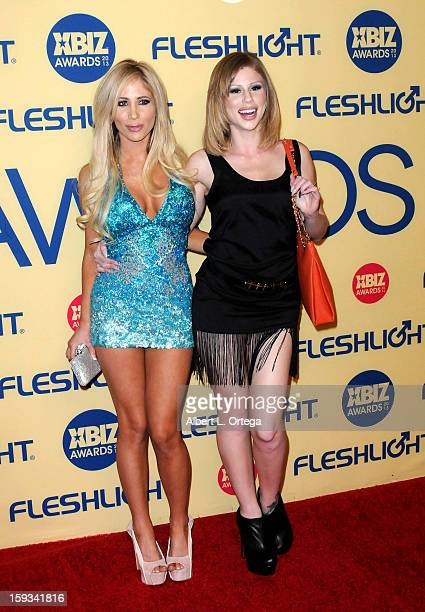 Adult Film actress Sasha Reign and adult film actress Brooklyn Lee arrive for the 2013 XBIZ Awards held at the Hyatt Regency Century Plaza on January...