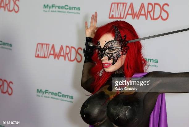 Adult film actress ShandaFay body painted to look like the character Batgirl from the Batman comic book franchise attends the 2018 Adult Video News...