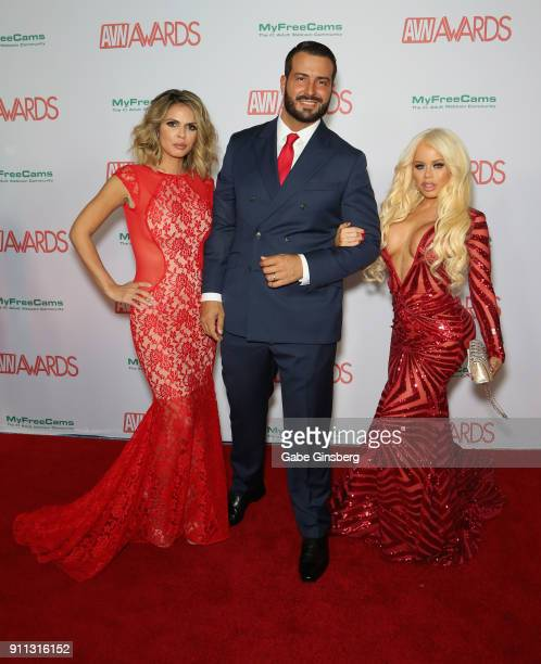 Adult film actress Shy Love adult film actor Romeo Mancini and adult film actress Nikki Delano attend the 2018 Adult Video News Awards at the Hard...