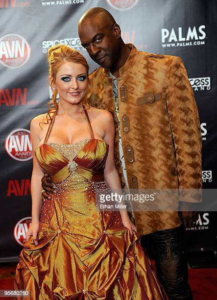 Adult film actress Sophie Dee and adult film actor Lee Bang arrive at the 27th annual Adult Video News Awards Show at the Palms Casino Resort January...