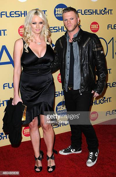 Adult film actress Stormy Daniels and adult film actor Brendon Miller arrive for the 2013 XBIZ Awards held at the Hyatt Regency Century Plaza on...
