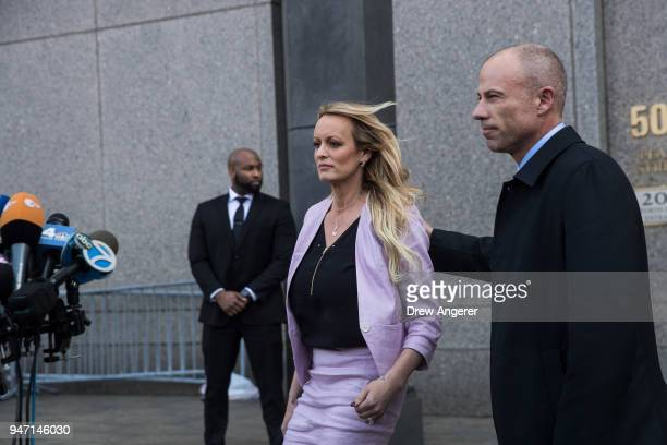 Adult film actress Stormy Daniels and Michael Avenatti attorney for Stormy Daniels exit the courthouse and speak to the media as they exit the United...