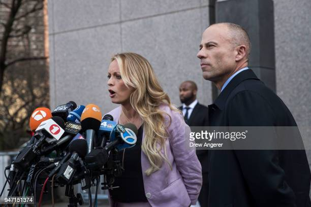 Adult film actress Stormy Daniels and Michael Avenatti attorney for Stormy Daniels speak to the media as they exit the United States District Court...