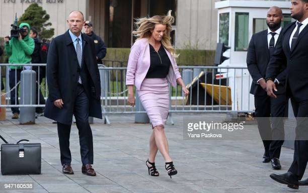 Adult film actress Stormy Daniels prepares to leave Federal Court with her lawyer Michael Avenatti at the United States District Court Southern...