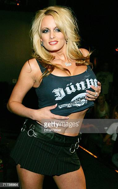 Adult film actress Stormy Daniels presents a creation by Junker Designs during a fashion show debuting the company's new collection at the Rainbow...