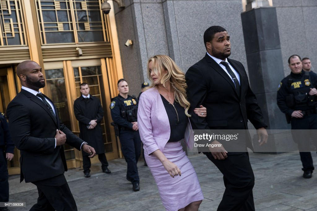 Adult film actress Stormy Daniels (Stephanie Clifford) speaks to reporters as she exits the United States District Court Southern District of New York for a hearing related to Michael Cohen, President Trump's longtime personal attorney and confidante, April 16, 2018 in New York City. Cohen and lawyers representing President Trump are asking the court to block Justice Department officials from reading documents and materials related to Cohen's relationship with President Trump that they believe should be protected by attorney-client privilege. Officials with the FBI, armed with a search warrant, raided Cohen's office and two private residences last week.