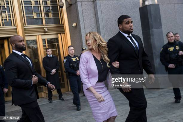 Adult film actress Stormy Daniels speaks to reporters as she exits the United States District Court Southern District of New York for a hearing...