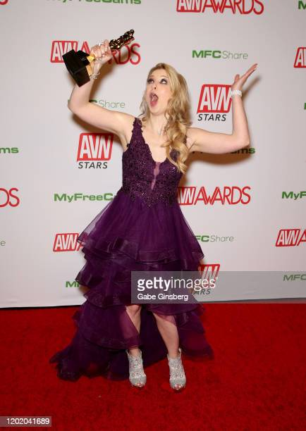 Adult film actress Sunny Lane poses with her trophy for being inducted into the AVN Media Network's Hall of Fame during the 2020 Adult Video News...